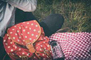 woman s red with polka dot print backpack